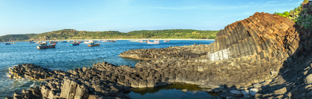 Panorama Da Dia Reef on sunny early sun on the stone path to the Giants Causeway beside the boats have yet to wake up