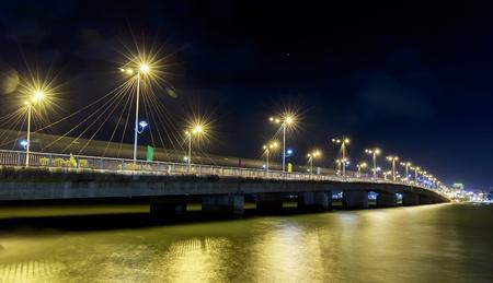 Khanh Hoa, Vietnam - February 2nd, 2015: Bridge Tran Phu, Nha Trang at night with the lights along the bridge across the bay star in Khanh Hoa, Vietnam