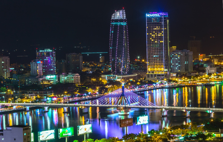 Da Nang, Vietnam, 25th June, 2015: Drawing beautiful city of Danang at night with the lights mounted bridge flamboyance. Here are gi? international fireworks competition every year in the city of Da Nang, Vietnam Editorial