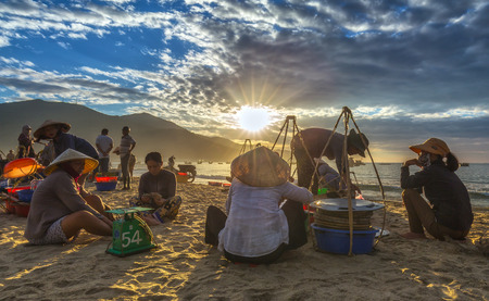 Da Nang, Vietnam, June 26, 2015: Market early fishing village buying Da nang khi ng??i busy selling fish, transport fish to Markets, sun rays radiating prepared very lively atmosphere, all living life in Da Nang, Vietnam