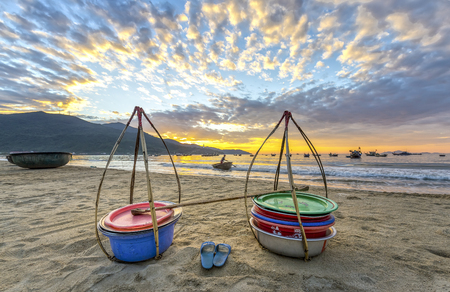 Da Nang, Vietnam, June 26, 2015: Double strickle, slippers expected to welcome the new day afar who Came back, this is vehicle for trafficking Fishermen fish in waters over simple, rustic but rich emotional meaning of life Stock Photo - 72055878