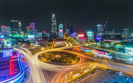 Ho Chi Minh City, Vietnam - July 23rd, 2015: Impressive beauty, colorful city lights up traffic khi, the trail vehicle in crowded Quach Thi Trang Roundabout, Ho Chi Minh city, Vietnam