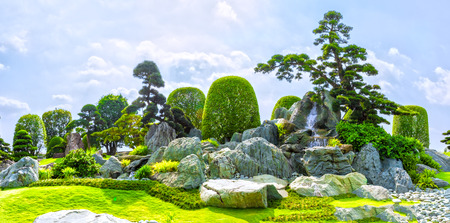 to incorporate: Ho Chi Minh City, Vietnam - March 3rd, 2014: Bonsai garden beauty with many cypress, pine, stone architecture and ancient trees as paintings incorporate blending in Ho Chi Minh City, Vietnam. Editorial