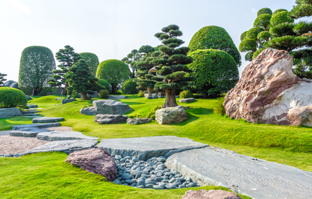 Ho Chi Minh City, Vietnam - March 3rd, 2014: Japanese rock gardens in Vietnam with many beauty cypress, pine perpetual and harmonious stone architecture in a beautiful picture in Ho Chi Minh City, Vietnam