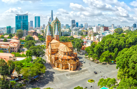Ho Chi Minh City, Vietnam - July 17th, 2015: The beauty of Notre Dame cathedral architecture buildings over a hundred years old, so far is the high rise buildings for the Economic Development in Ho Chi Minh City, Vietnam Editorial