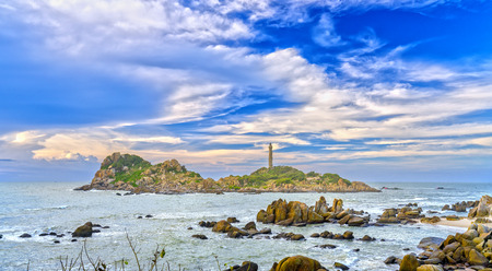 Sunny early in the century-old lighthouse with dramatic clouds and Reefs to Attract tourists to visit