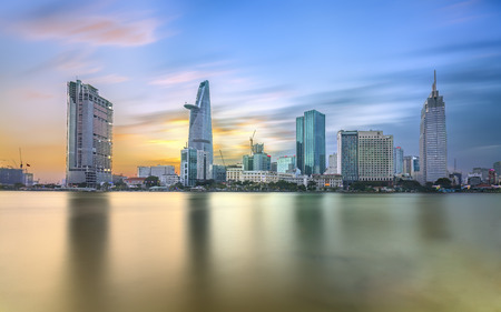 Ho Chi Minh City, Vietnam - February 14th, 2017: Beauty skyscrapers along river smooth light down urban development in Ho Chi Minh City, Vietnam Editorial