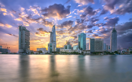Ho Chi Minh City, Vietnam - February 14th, 2017: Beauty skyscrapers along river smooth light down urban development in Ho Chi Minh City, Vietnam Stock Photo - 73978983