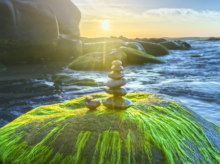 The stones are balanced on the rocks welcome the beautiful morning
