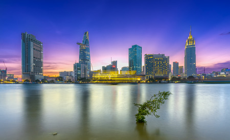 Ho Chi Minh City, Vietnam - March 25th, 2017: Riverside City sunrays clouds in the sky at end of day brighter coal sparkling skyscrapers along beautiful river in Ho Chi Minh City, Vietnam Editorial