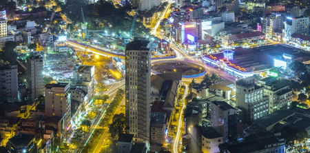 Ho Chi Minh City, Vietnam - April 11, 2017: Aerial night view of colorful and vibrant cityscape of downtown with traffic light trails Editorial
