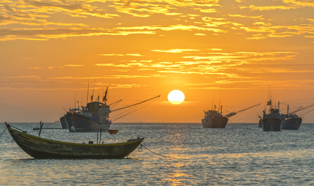 ne: Mui Ne, Vietnam, Sunset at Fishing village and traditional fishing boats in Mui Ne, Vietnam