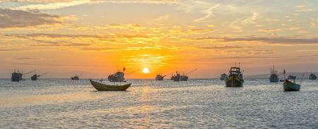 Mui Ne, Vietnam - February 18th, 2017: Sunset at Fishing village and traditional fishing boats in Mui Ne, Vietnam Editorial