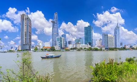 May 1st, 2017: Skyscrapers along the river with architecture office towers, hotels, cultural center and commercial development in Ho Chi Minh City, Vietnam