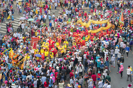 marched: Binh Duong, Vietnam - February 11th, 2017: Chinese Lantern Festival with colorful dragons, lion, flags, cars, marched in the streets attracted crowd. This traditional festivals ethnic Chinese in Vietnam Editorial