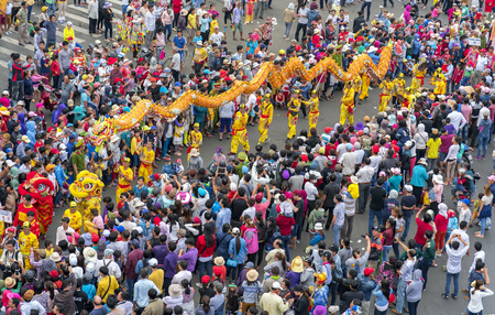 marched: Binh Duong, Vietnam - February 11th, 2017: Chinese Lantern Festival with colorful dragons marched in the streets attracted by crowd. This traditional festivals of ethnic Chinese in Vietnam
