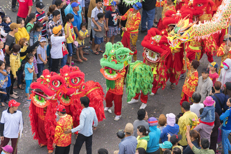 11th: Binh Duong, Vietnam - February 11th, 2017: Chinese Lantern Festival with colorful dragons, lion, flags, cars, marched in the streets attracted crowd. This traditional festivals ethnic Chinese in Vietnam Editorial