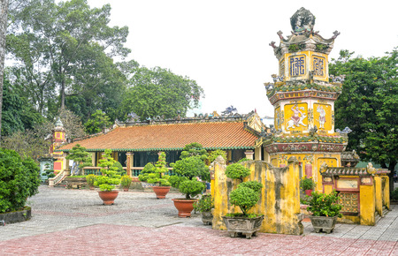 Binh Duong, Vietnam - February 5th, 2017: Architecture temple tower with large yard and house