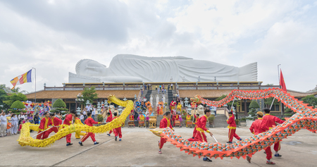 Binh Duong, Vietnam - February 5th, 2017: Festival in the old temple has beautiful architecture with dance dragon martial arts students performed in Chinese Lantern Festival in Binh Duong, Vietnam