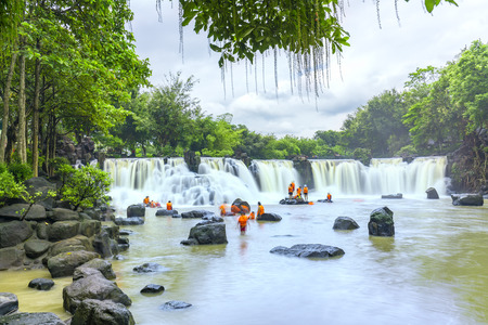 Dong Nai, Vietnam - June 25th, 2017: Beautiful waterfalls in Ecotourism with water flowing smooth as silk attract tourists to visiton a sunny summer day in Dong Nai, Vietnam Stock Photo