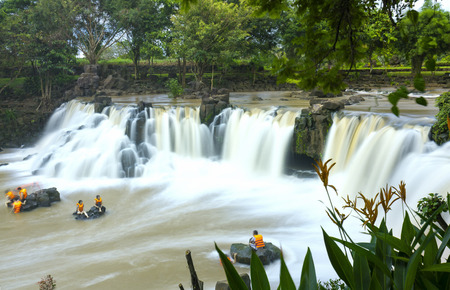 Dong Nai, Vietnam - June 25th, 2017: Beautiful waterfalls in Ecotourism with water flowing smooth as silk attract tourists to visiton a sunny summer day in Dong Nai, Vietnam Editorial