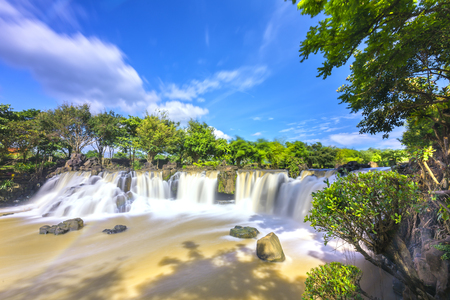 Beautiful waterfalls in Ecotourism with water flowing smooth as silk attract tourists to visit on a sunny summer day