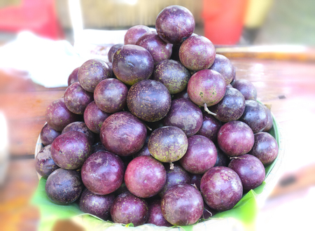 Ripe purple star apple fruit is stacked for sale to consumers Stock Photo
