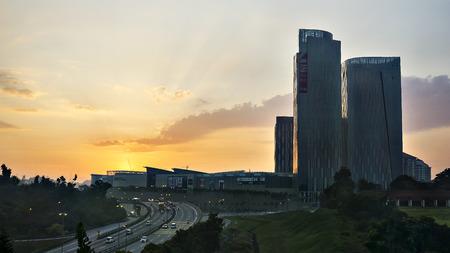 january sunrise: PUTRAJAYA, MALAYSIA - January 12, 2015: Landscape of interest sunrise behind IOI City Mall shopping center at Putrajaya, Malaysia.