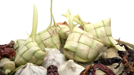 the casing: Ketupat or rice dumpling is a local delicacy during the festive season. Ketupat, a natural rice casing made from young coconut leaves for cooking rice