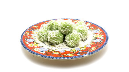 Malay traditional delicacy, in Malaysia called buah melaka. be of glutinous rice and filled with palm sugar or brown sugar.
