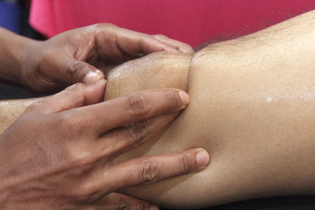 back ache: Sports massage - Arm massage - Physical therapist doing massage of arms. Toned image, selective focus set on hands.