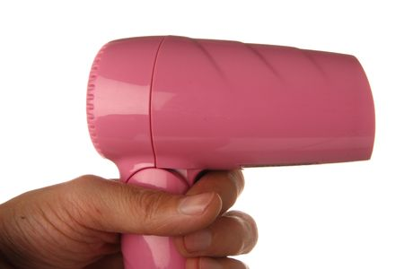 hand holding pink hairdrier photo