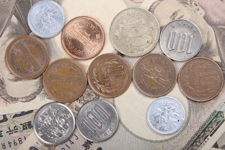 exoticism: Japanese Yen and coins Stock Photo