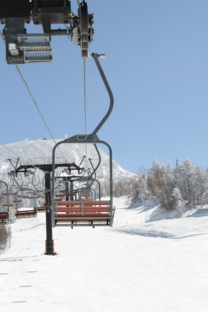 chair lift in snowy winter landscape photo