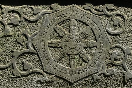 stone dharma wheel photo