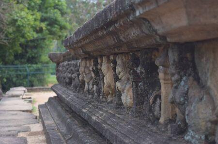 Old stone wall at a bathing Pool, in Kumara Pokuna, Royal Palace Group, Polonnaruwa, Sri Lanka