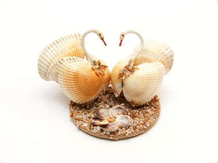 Souvenir from sea cockleshells as swans Banco de Imagens