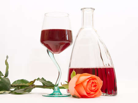 Red wine in a glass and a rose photo
