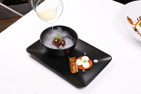 provocative food: Molecular Cuisine. Delicious soup with beetroot. Stock image.