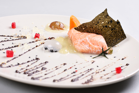 faked: Smoked salmon with herbs, faked salmon roe. Sauce cooked by molecular gastronomy technic. Stock Photo