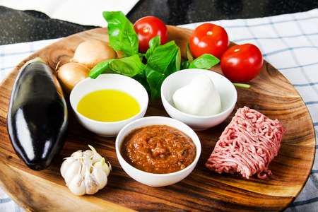 ingredients for cooking parmigiana di melanzane: baked eggplant - italy, sicily cousine. Stock image. Stock Photo