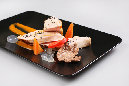 Chicken breast with vegetables on a white plate. Foto de archivo