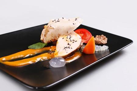 Chicken breast with vegetables on a white plate. Zdjęcie Seryjne