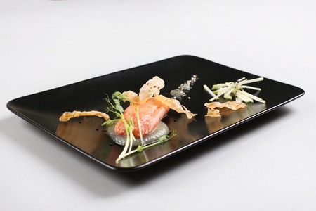 Smoked salmon with herbs, faked salmon roe. Sauce cooked by molecular gastronomy technic. 스톡 콘텐츠