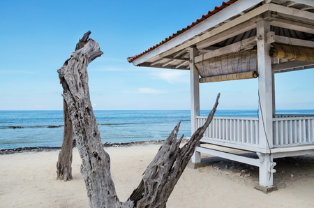 White wooden shelter from the sun on the beach in Bali. Stock image.