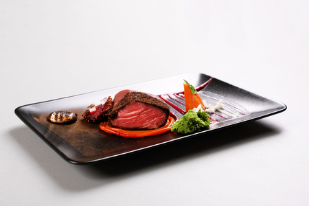 Delicious veal fillet served with sauce, molecular froth and beetroot. Stock image. Foto de archivo