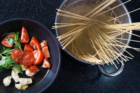 pasta with artichoke and tomatoes sauce. stok image.