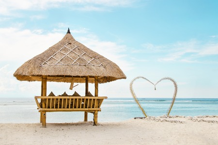 Wooden shelter from the sun on the romantik beach in Bali. Stock image.
