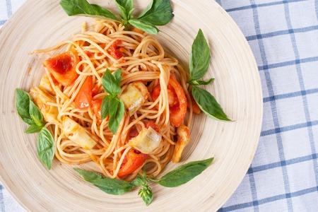 Pasta with artichoke and tomatoes sauce. stok image. Foto de archivo