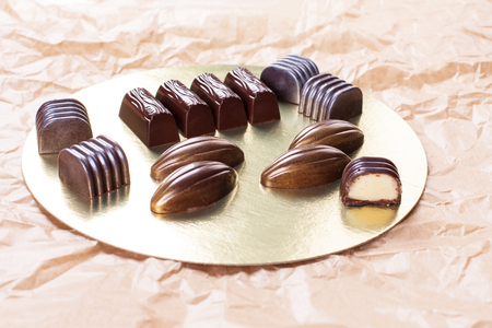 Assorted dark chocolate candies. Stock image.